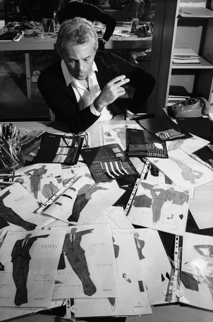 Giorgio Armani looks over designs in his studio, 1979.
