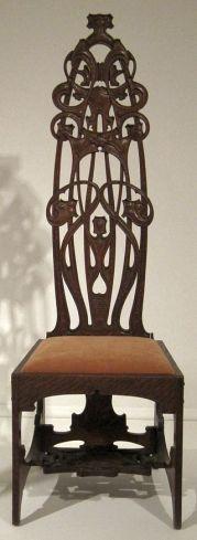 Cadeira de carvalho por Charles Rohlfs, 1898-99.